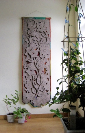 "Felt Floral I, wall hanging, industrial wool felt, nylon gauze backing and trim, buttons, beads, bamboo rod, 22"" x 65"""