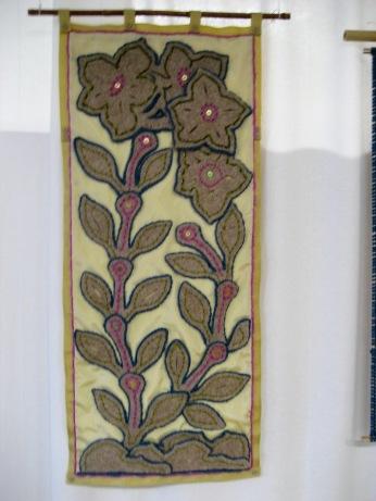 "Felt Floral III, wall hanging, industrial wool felt, silk taffeta, buttons, wool yarn, 18"" x 44"""