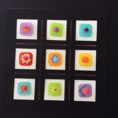 Nine Posies, layered cut papers, beads